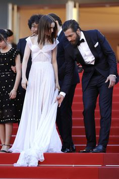 """Lily Collins Photos Photos - Actors Lily Collins and Jake Gyllenhaal attend the """"Okja"""" screening during the 70th annual Cannes Film Festival at Palais des Festivals on May 19, 2017 in Cannes, France. - 'Okja' Red Carpet Arrivals - The 70th Annual Cannes Film Festival"""