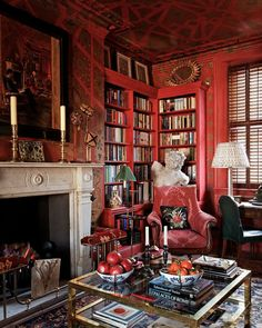 richly patterned red London library of designer Alidad