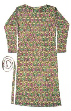 From the personal wardrobe of Marilyn :  A Pucci dress of printed silk jersey, geometric patterns in greens and pinks, with boat neck and long sleeves together with matching belt. Marilyn wore this dress for her 'Vogue' photo shoot with photographer Bert Stern, and also during her trip to Mexico in February, 1962.