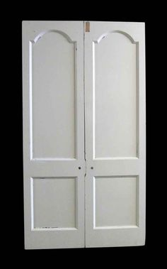 White painted narrow two panel wooden doors. Priced as a double.