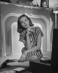 Lauren Bacall - In 1945, she showed off a customary combination: striped tailored dress, smart wedges, and a cigarette.
