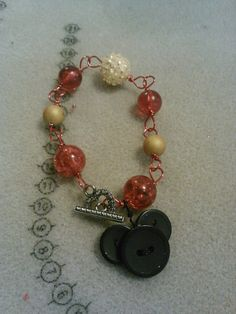 Redyellowand black mouse charm bracelet by CRAZYBUTTONDESIGNS13, $7.00