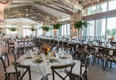 Coastal greenery and pops of color! We loved this #wedding #reception in our Grand Ocean Terrace wedding #venue! #BeachWedding #CoastalWedding