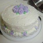 Stunning White Wilton Cake Decorating Idea with Purple Flowers a part of Stunning White Wilton Cake Decorating Idea With Purple Flowers under Birthday Cakes
