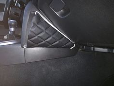 Close up view of the DIY pocket knee pad attachment for the Scion FRS, made with black diamond stitch padded vinyl, white piping and Velcro backing.