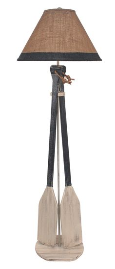 """Perfect for the lake cabin, the Cottage Navy 2-Paddle Floor Lamp stands 62"""" high and is highlighted with nautical navy and white washed paddles and topped with a fun burlap shade."""
