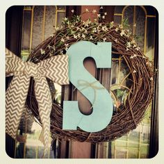 Fun and easy diy wreath for front door! I really like the rustic look of the wreath mixed with the simple initial and bow.