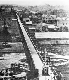 An elevated bicycle path from Pasadena to Los Angeles circa 1900.