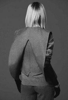 Split-back gilet with structured shape, minimalist tailoring, creative pattern…
