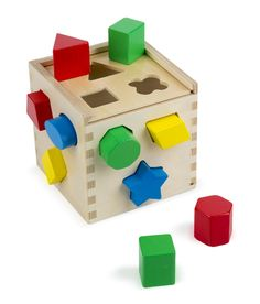 Shape Sorting Cube: This is a time-tested classic wooden baby toy that will give your child hours of fun
