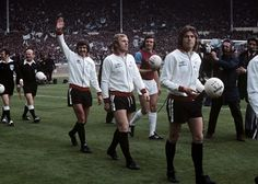 Fulham players Alan Slough, Bobby Moore and John Mitchell walk onto the pitch for the FA Cup Final Get premium, high resolution news photos at Getty Images Fulham Fc, Bobby Moore, Class Games, Fa Cup Final, London Look, Retro Football, Wembley Stadium, Soccer World, World Star
