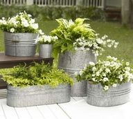This looks like a truly neat productGalvanized metal tubs as planters