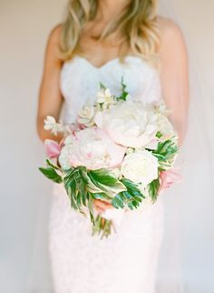 """The bride wanted an """"elegant but not stuffy"""" bouquet, and that's exactly what she got withthis arrangementof peonies, roses, and greenery."""