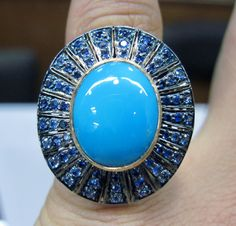 Natural Arizona Piece Of Turquoise Set As A Center Piece With Studded Blue Sapphire In A Ring By Gemvanity. See More @ https://www.facebook.com/Gemvanity