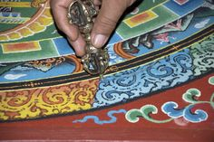 Traditionally created as a tool for visualization and meditation, every single detail of a mandala—the design, the colors, and placement of symbols—is deliberate. The blueprints are considered sacred, with many layers of deep meaning and positive representation. Before beginning, traditional mandala artists generate the intention to benefit others and the motivation of compassion, which is believed to infuse the art or structure with unique spiritual and sacred qualities.