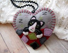 Hey, I found this really awesome Etsy listing at https://www.etsy.com/listing/193926393/tuxedo-cat-napping-ornament