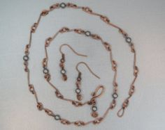 This delicate necklace is hand made from sterling silver wire. It has a viintage look and reminds me of a necklace I inherited from my aunt. It measures approximately 18 inches in length. The beads are glass pearls that are uniform in shape and have the luster of pearls. A pair of simple matching earrings is included with this necklace. If you like the necklace, but want different colored beads, message Memos to explore a custom order. There would be no extra charge if we have the color you…