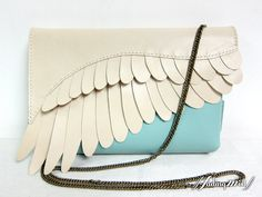 2-Tone Leather Feather Clutch Bag. $109.00, via Etsy.