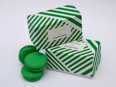 Green macarons by Ladurée wrapped in a box featuring the legendary Carven green