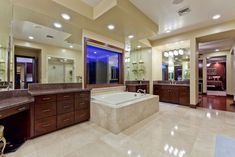 Craftsman master bathroom with red granite counters and travertine floors