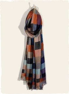 The plaid scarf is woven in bright, contemporary hues in a soft wool blend. Mod Plaid Scarf from PeruvianConnection.com