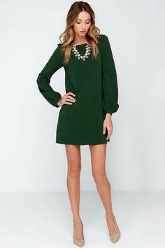 Green short dress, nude pointy shoes, fake diamond necklace