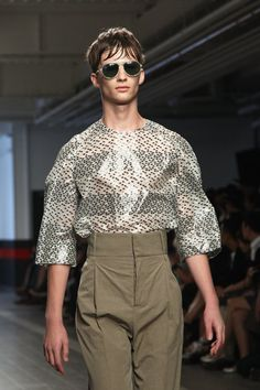 Fashion Week: Plastic shirts and high-waist pants? No wonder he's sweating out his bangs.
