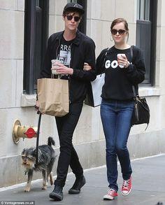 Still on? Dakota hasn't been spotted with her beau Matthew Hitt, left, since June - pictur...