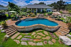 Semi Inground Pools Ideas in Rectangular and Curved Shapes: Small Blue Semi Inground Pools With The Wide Green Garden Brown Floor And The Stone Staircases ~ SFXit Design Pool Inspiration