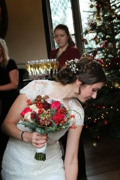 http://flowerdesignstannes.blogspot.co.uk/2014/12/christmas-reindeers-beetroot-red-for.html Bridal hair and makeup by Alison at www.kittywinkvintage.co.uk