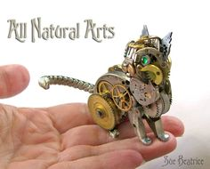 All Natural Arts added 2 new photos.  I'm sure you've all heard of a watch dog. How about a watch cat? This emerald eyed kitty is made entirely from antique watch parts.