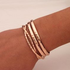 This is a beautiful set of rose gold bracelets. These bracelets all have a deep rich hammer blow that catches the light nicely. The thin cuffs #GoldBracelets