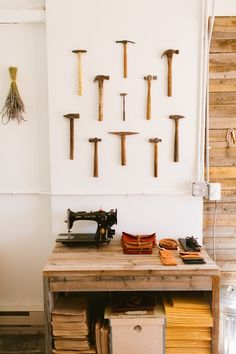 Collection of Hammers hung on the wall from Stitch & Hammer