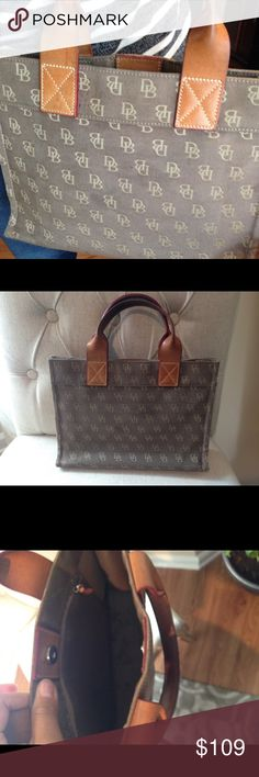 Dooney and Burke Rectangular Monogram Purse Good condition, great for the office and fits a iPad or tablet nicely! Classy, 12x9 inches Dooney & Bourke Bags Totes