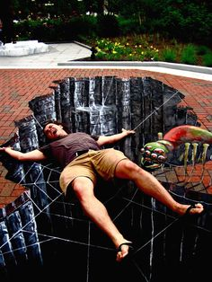 Street Art Paintings – street art by Chris Carlson- idk what i like more; the street art or the phot… 3d Street Art, Murals Street Art, Amazing Street Art, Street Art Graffiti, Amazing Art, Awesome, Trompe L Oeil Art, Pavement Art, 3d Chalk Art
