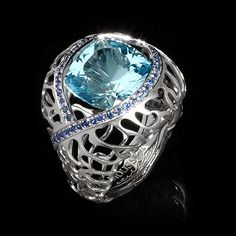 Mousson atelier, collection Coral Reef, ring, White gold 750, Sky topaz 8,34 ct., Sapphires