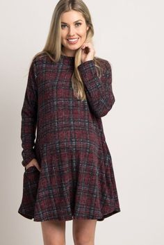 This maternity sweater dress is the perfect fall essential. With its soft material and deep plaid print, you'll be comfortable from day to night, with this chic ensemble. This dress will keep any mom comfortable for work or play and can be dressed up with a statement necklace and heels for a stunning ensemble.