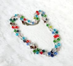 Vintage Necklace  Beautiful Festive Multi Colored Faceted Glass Bead Necklace with silver-tone fillers between each bead. This is extra long