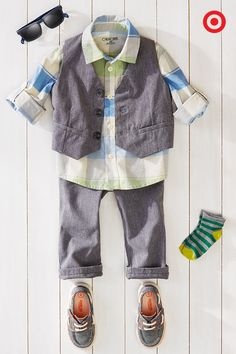 Brunching with your little boy? Keep him casually on-trend with this easy outfit. Add a pop of color to his gray vest and pants with this plaid shirt. Add boat shoes, a sweet pair of sunglasses, and he's ready to go.