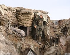 Soldier from the York and Lancaster regiment in a front line trench, WW1.  A sniper of the 6th Battalion, York and Lancaster Regiment outside his post on the front line. It was taken by Second Lieutenant Davis McLellan on 6 February 1918 near Cambrin, in France. Trench warfare led to large periods of boredom, but even in the static conditions of trench warfare there was a constant threat from random shelling and snipers on both sides.