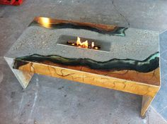 Custom concrete coffee table with eco-friendly burner stained and polished river rock!   www.superiorstainstx.com