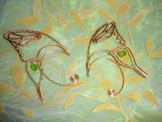 @Jen Gentry Camp  - maybe an alternative for Tamriel?  Gold Butterfly Wing Ear Cuffs by KimberlyNichole on Etsy, $35.00