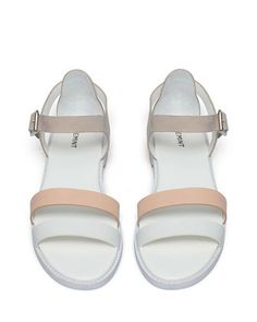 white and beige sandals