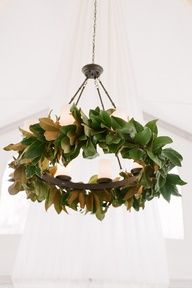 magnolia light fixture mixed with the olive eucalyptus garland and flowers
