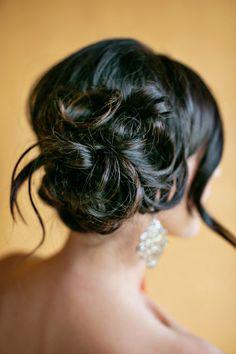 bun curls // photo by Chard Photographer // http://ruffledblog.com/emerald-and-champagne-wedding-ideas
