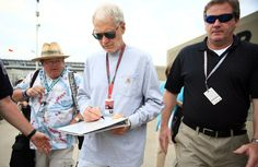 May 24, 2015; Indianapolis, IN, USA; IndyCar Series owner David Letterman signs an autograph before the 2015 Indianapolis 500 at Indianapolis Motor Speedway. (Andrew Weber, USA TODAY Sports)