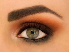 Orange eye shadow. You're already scared huh? Well, don't be! Orange shadow is a big trend for fall and it's much more wearable than you'd think! My favorite way to wear it is by warming up a traditional smoky eye by blending a gorgeous burnt orange into the crease.