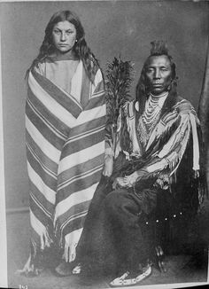 American Indians : Old Crow and wife Pretty Medicine Pipe - Crow 1873. http://www.firstpeople.us/photographs2/Old-Crow-and-wife-Pretty-Medicine-Pipe-Crow-1873.html