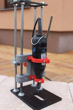 Rotary Tool Drill Press by mitchnajmitch -- Homemade rotary tool drill press constructed from 3D-printed parts, round rod, threaded rod, bearings, and hardware. http://www.homemadetools.net/homemade-rotary-tool-drill-press-5