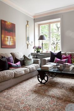 light gray living room. Love the carpet, pillows and lighting accents